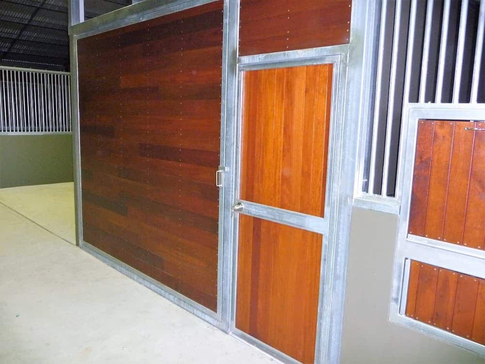Revolving tack room wall steel frame hardwood timber lined closed