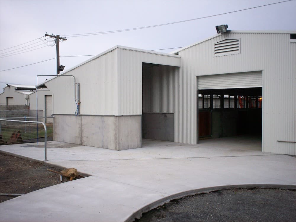 External open and enclosed washbay half height precast concrete panels colorbond wall cladding central pit drain galvanized steel rail