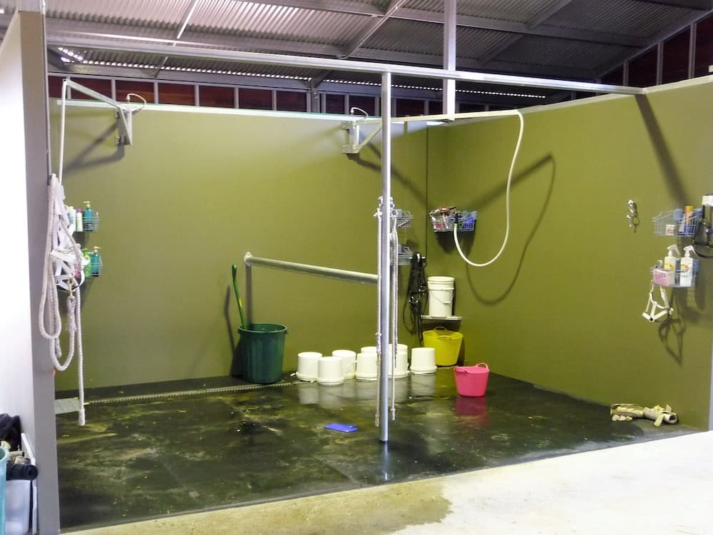 Internal double wash bay full height precast concrete walls rear trough drain rubber lined floor