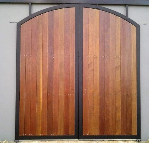 Stable barn doors sliding arch top timber lined powdercoated closed