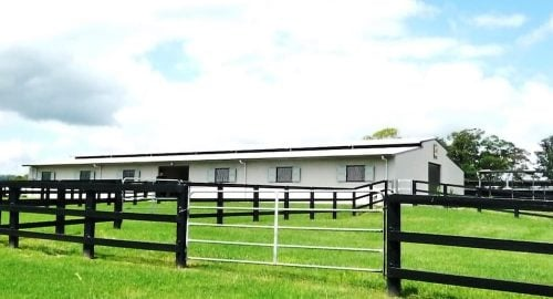 Yearling barn cross breezeway barn full height precast concrete walls colorbond shutters vent colorbond roof