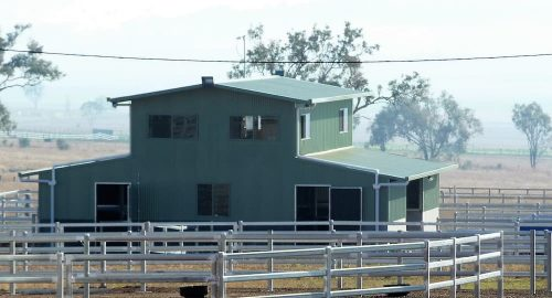 Horse stable with viewing room above precast concrete, colorbond walls, and colorbond roof