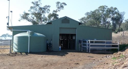 Horse stable breezeway barn half height precast concrete and colorbond walls vent day yard