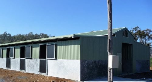 Stable barn half height precast concrete and colorbond walls breezeway vent rear form ply stable doors