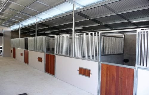 Breezeway barn half height precast concrete and grill hardwood timber and separate grill swinging stable doors rotating feed bins