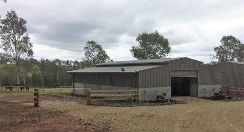 Breezeway barn half height precast concrete and colorbond walls vent colorbond roof