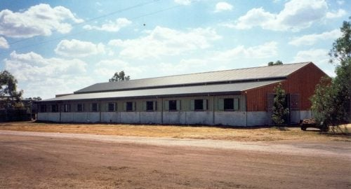 Large stable breezeway barn half height precast concrete walls colorbond and timber wall cladding colorbond shutters ventilated colorbond roof
