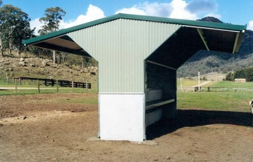 Horse paddock shade shelter precast concrete colorbond wall with feed trough