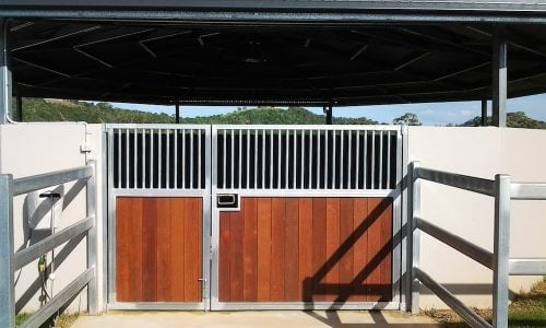 Horse round yard straight wall precast concrete panel and combined segmented colorbond roof steel and hardwood timber doors steel fence