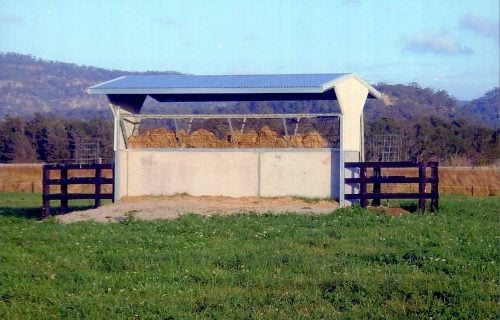 Horse paddock shade shelter precast concrete colorbond wall with hay rack