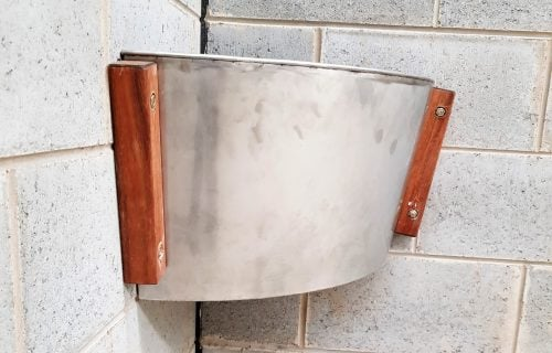 Stainless steel drop in corner feed bin - Custom Horse Stables - Signature Stables