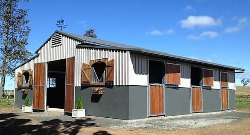 Stable barn half height precast concrete and colorbond walls breezeway vent hardwood shutters and swinging entry doors and rear stable doors