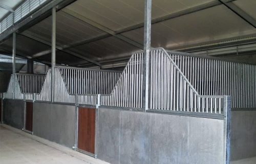 Stable complex half height precast concrete wave top galvanized steel grill swinging hardwood timber lined stable doors