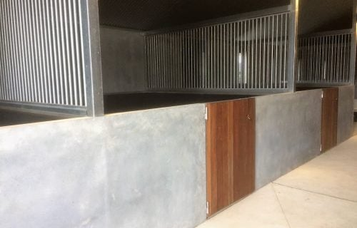 Modern stable barn half height precast concrete panels wall custom made swinging stable door hardwood timber lined